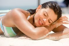 Woman lying at the beach Royalty Free Stock Photo