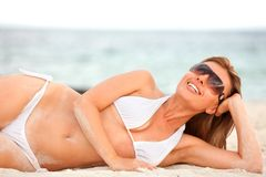 Woman lying on the beach Royalty Free Stock Images