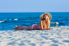 Woman lying on the beach Stock Photo