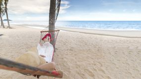 Woman lying in the beach cradle royalty free stock photo