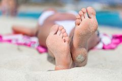 Woman is lying on the beach Royalty Free Stock Photos