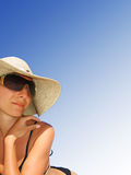 Woman lying on beach over gradient blue sky stock image