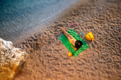 Woman lying on the beach Stock Photography