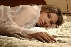 Woman lying on a bed Royalty Free Stock Photo