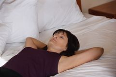 Woman Lying On Bed Royalty Free Stock Images