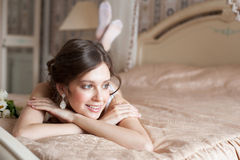 Woman lying on the bed Stock Image