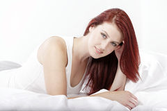 Woman lying on bed Royalty Free Stock Photos