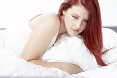 Woman lying on bed Stock Photo