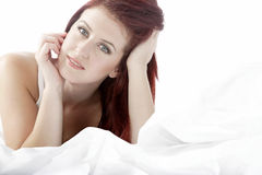 Woman lying on bed Royalty Free Stock Photo