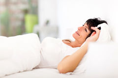 Woman lying bed Stock Photography