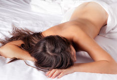 Bare Back and White Sheets Royalty Free Stock Photography
