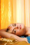 Woman lying in bed Royalty Free Stock Image
