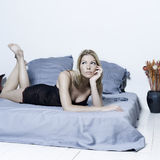 Woman lying on a bed Stock Photo