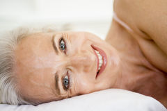 Woman lying in bed Stock Photography
