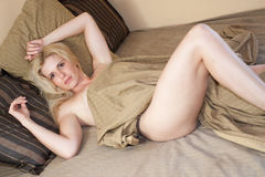 Woman lying on bed Stock Photography