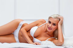 Woman lying on bed Royalty Free Stock Image