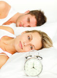 Woman lying in bed with her boyfriend Stock Image