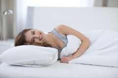 Woman lying on the bed at home Royalty Free Stock Photography
