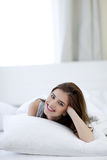 Woman lying on the bed at home Royalty Free Stock Photo