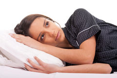Woman lying in bed with my eyes open Royalty Free Stock Photos