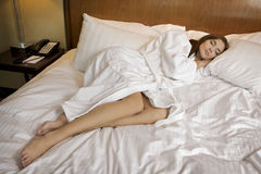 Woman lying in bed sleeping Royalty Free Stock Image
