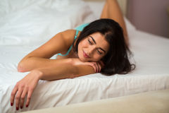 Woman is lying in bed. Royalty Free Stock Photography
