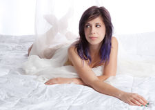 Woman Lying on Bed With White Comforter Royalty Free Stock Photos