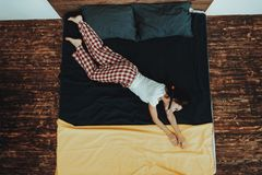 Girl is Imitating Divers in Water on Bed stock images