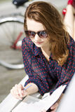 Woman lying on bench and enjoys reading Royalty Free Stock Image