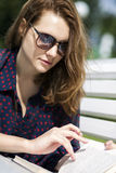 Woman lying on bench and turn page Royalty Free Stock Images