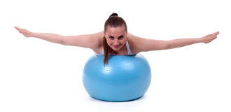 Woman  lying on the big blue ball Stock Images