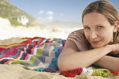 Woman Lying On Blanket At Beach Stock Photos