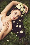 Woman lying on blooming meadow of buttercup and camomile Royalty Free Stock Photos