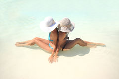 Woman lying in blue pool Royalty Free Stock Photo