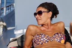 Woman lying boat sunbathing Royalty Free Stock Photo