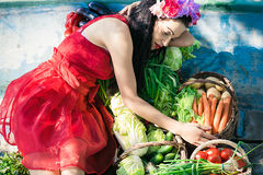 Woman lying in a boat with vegetables Royalty Free Stock Photos