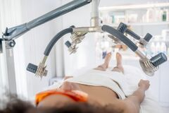 Woman lying on body contouring session