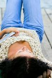 Woman lying with book Royalty Free Stock Images