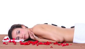 Woman lying on a brown mat Royalty Free Stock Photography