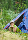 Woman lying in camp tent Royalty Free Stock Images