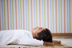 Woman lying in the carpet Royalty Free Stock Photography