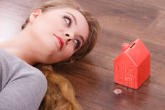 Woman lying with cash box. Stock Images