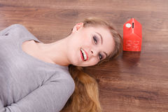 Woman lying with cash box. Royalty Free Stock Image