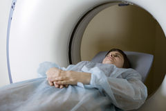 Woman Lying In CAT Scan Machine Royalty Free Stock Photography
