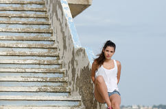 Woman lying on cement stairs Stock Images