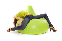 Woman lying on chair. Woman lying on green chair Stock Image