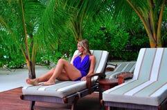 Woman lying on chaise longue. On the tropical beach stock photos