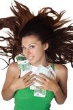 Woman lying and clasp money euro to breast hair. Beautiful woman lying and clasp money euro to breast and hair is dishevelled isolated Stock Photography