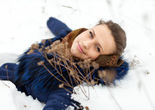 Woman lying in coat on the  snow Stock Photos