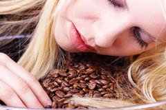 Woman lying on coffee beans Royalty Free Stock Photography